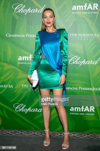 Model Petra Nemcova attends the amfAR Paris Dinner 2018 at The Peninsula Hotel on July 4 2018 in Paris France