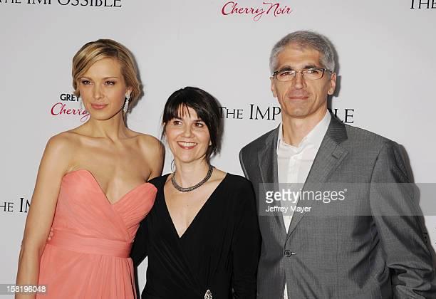 Model Petra Nemcova producer Maria Belon and Enrique Alvarez arrive at the 'The Impossible' Los Angeles Premiere at ArcLight Cinemas Cinerama Dome on...