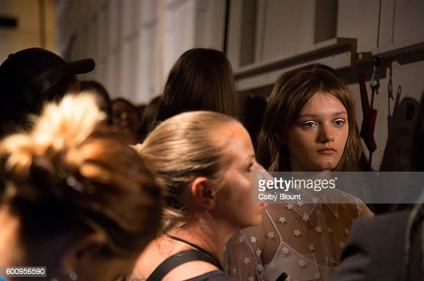 Model Peyton Knight prepares backstage at Noon by Noor fashion show during New York Fashion Week The Gallery Skylight at Clarkson Sq on September 8...