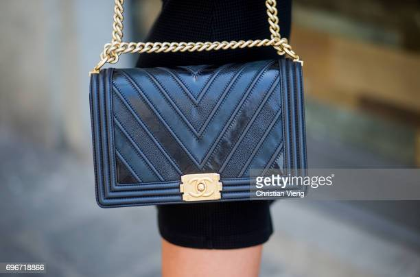 Model Pharis Willauer wearing a black dress Chanel bag white sneakers is seen during Pitti Immagine Uomo 92 at Fortezza Da Basso on June 16 2017 in...