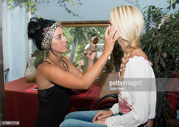 Model Phillisha Holloway getting touched up for her photo shoot by Makeup Artist Carissa Pacheco with Ormana Argan Miracle Oil at The SAP The...