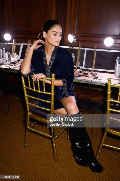 Model Pia Wurtzbach prepares backstage during the NYFW Sherri Hill Runway Show on February 9 2018 in New York City