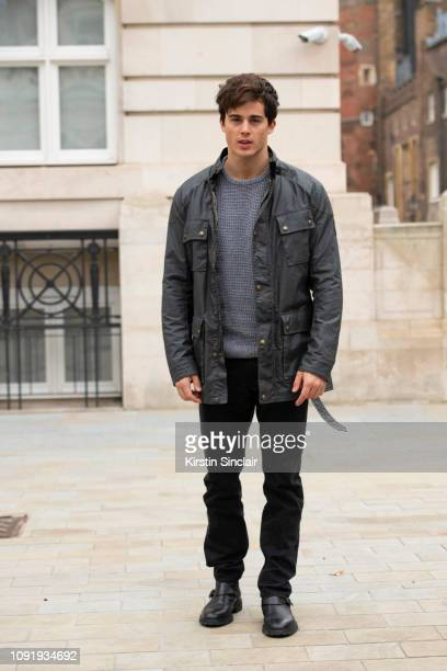 Model Pietro Boselli wears a Belstaff jacket with a grey jumper black jeans and black shoes during London Fashion Week Men's January 2019 on January...