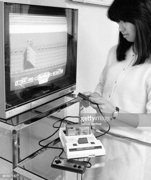 Model plays Nintendo's Family Computer on January 30, 1985 in Japan. Family Computer was on sale on July 15, 1983 and achieved 63 million sales all...