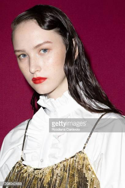 Model Polina Zavialova is seen backstage at the MSGM fashion show on February 22, 2020 in Milan, Italy.