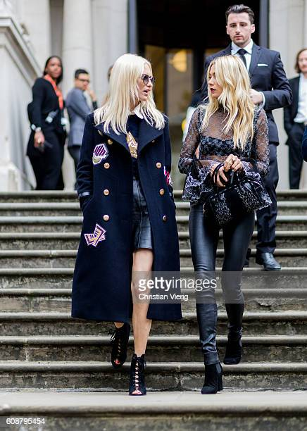 Model Poppy Delevingne and Jessica Hart outside Christopher Kane during London Fashion Week Spring/Summer collections 2017 on September 19 2016 in...