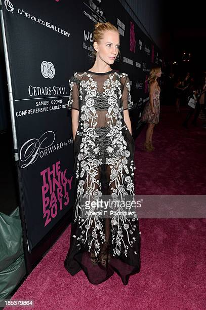 Model Poppy Delevingne attends Elyse Walker Presents The Pink Party 2013 hosted by Anne Hathaway at Barker Hangar on October 19 2013 in Santa Monica...