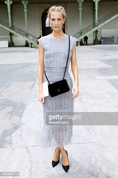 Model Poppy Delevingne attends the Chanel show as part of Paris Fashion Week Haute Couture Fall/Winter 20142015 Held at Grand Palais on July 8 2014...