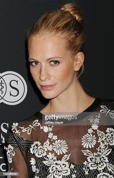 Model Poppy Delevingne attends The Pink Party 2013 at Barker Hangar on October 19 2013 in Santa Monica California