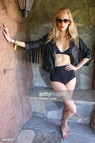 Model Poppy Delevingne attends the Superdry Coachella brunch hosted by Poppy Delevingne on April 12 2014 in Palm Springs California
