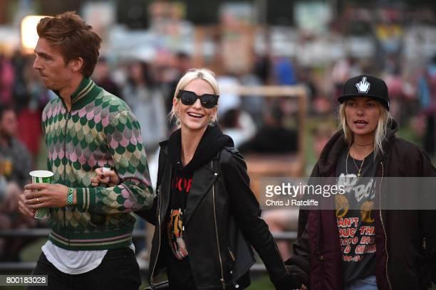 Model Poppy Delevingne husband James Cook and Jessica Hart attend Glastonbury Festival on June 23 2017 in Glastonbury England
