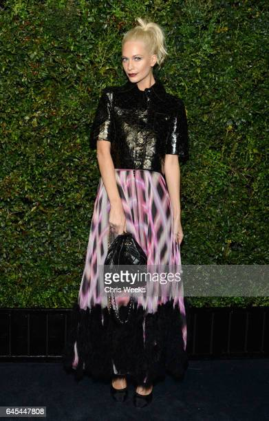 Model Poppy Delevingne wearing CHANEL attends the Charles Finch and CHANEL PreOscar Awards Dinner at Madeo Restaurant on February 25 2017 in Beverly...