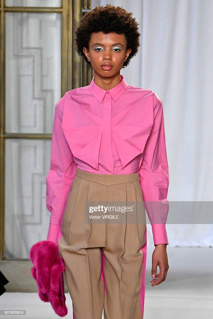 Model Poppy Okotcha walks the runway at the Delpozo Ready to Wear Fall/Winter 2018-2019 fashion show during London Fashion Week February 2018 on February 18, 2018 in London, England.