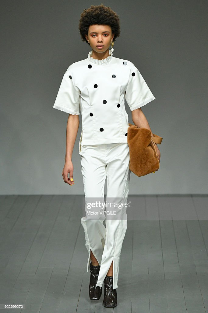 Model Poppy Okotcha walks the runway at the Eudon Choi Ready to Wear Fall/Winter 2018-2019 fashion show during London Fashion Week February 2018 on February 20, 2018 in London, England.