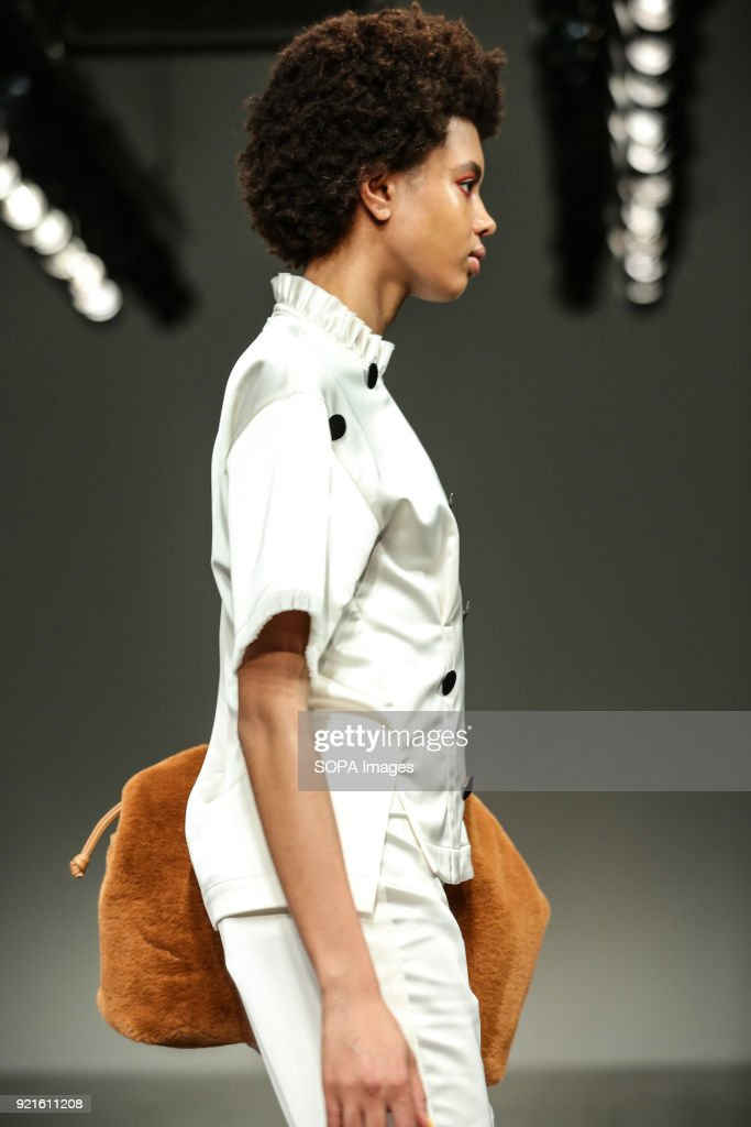 Model Poppy Okotcha walks the runway at the Eudon Choi Show during London Fashion Week February 2018 at BFC Show Space.