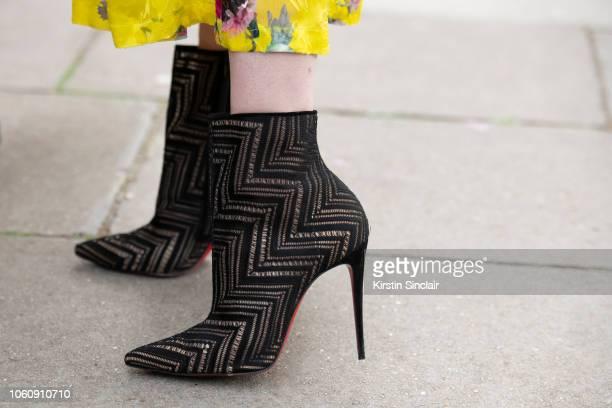 Model Portia Freeman wears Christian Louboutin boots during London Fashion Week September 2018 on September 16 2018 in London England