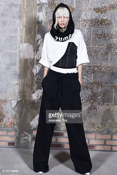 A Model pose backstage at the FENTY PUMA by Rihanna AW16 Collection during Fall 2016 New York Fashion Week at 23 Wall Street on February 12 2016 in...