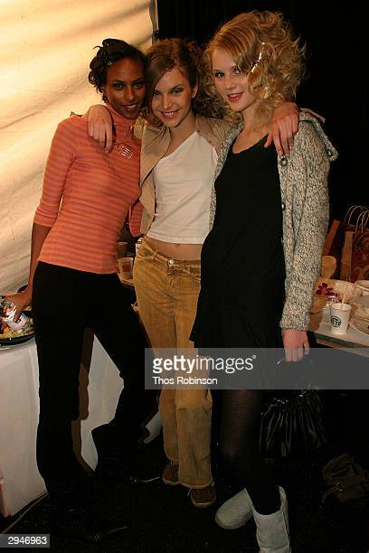 Model pose backstage during Olympus Fashion Week at Bryant Park February 8 2004 in New York City