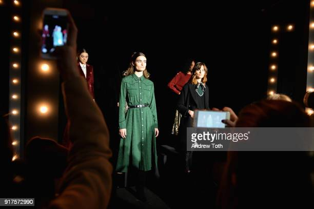A model pose on the runway for the Veronica Beard Fall 2018 presentation at Highline Stages on February 12 2018 in New York City
