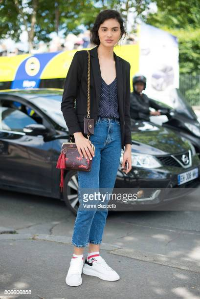 A model poses after the Dior show at the Hotel National des Invalides during Paris Fashion Week Haute Couture FW 17/18 on July 3 2017 in Paris France...