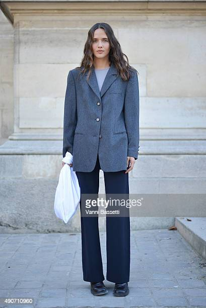 A model poses after the Lemaire show at the Jeu de Paume during Paris Fashion Week SS16 on September 30 2015 in Paris France