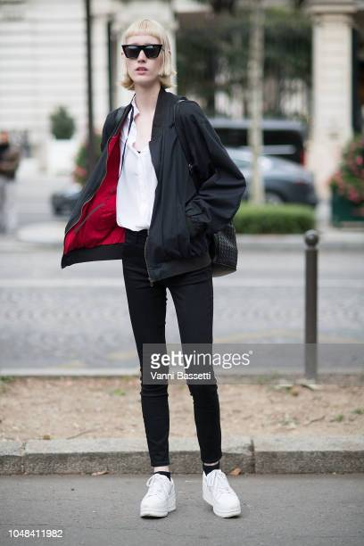 A model poses after the Miu Miu show at the Palais de Iena during Paris Fashion Week SS19 Womenswear on October 2 2018 in Paris France