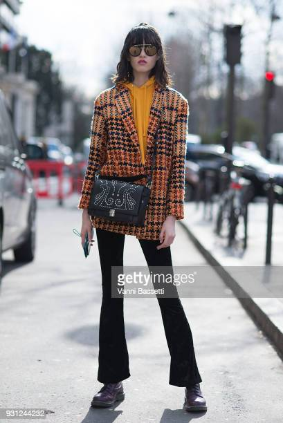 A model poses after the Miu Miu show at the Palais de Iena during Paris Fashion Week Womenswear FW 18/19 on March 6 2018 in Paris France
