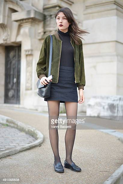 A model poses after the Shiatzy Chen show at the Grand Palais during Paris Fashion Week SS16 on October 6 2015 in Paris France
