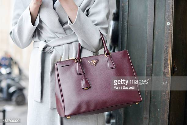 A model poses after the Wunderkind show wearing a Jil Sander coat and Prada bag on Day 7 of Paris Fashion Week Womenswear FW15 on March 9 2015 in...