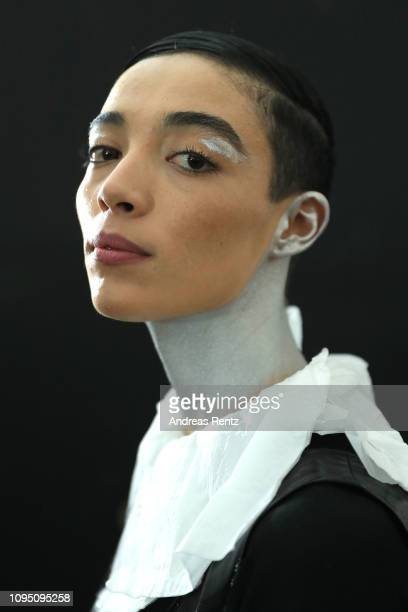 A model poses ahead of the Dawid Tomaszewski Defile during the Berlin Fashion Week Autumn/Winter 2019 on January 16 2019 in Berlin Germany