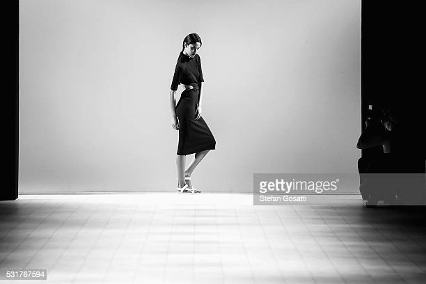A model poses ahead of the Karla Spetic show at MercedesBenz Fashion Week Resort 17 Collections at Carriageworks on May 17 2016 in Sydney Australia