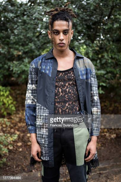 Model poses ahead of the Koche Womenswear Spring/Summer 2021 show as part of Paris Fashion Week at jardin des Buttes Chaumont on September 29, 2020...