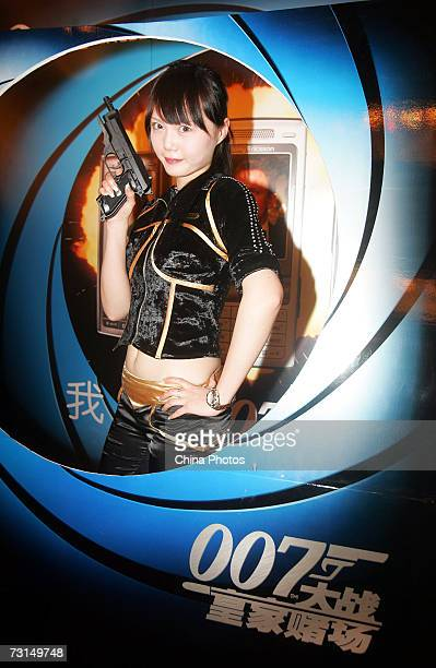 A model poses as a Bond Girl at a press conference before premiere of the film on January 30 2007 in Shanghai China