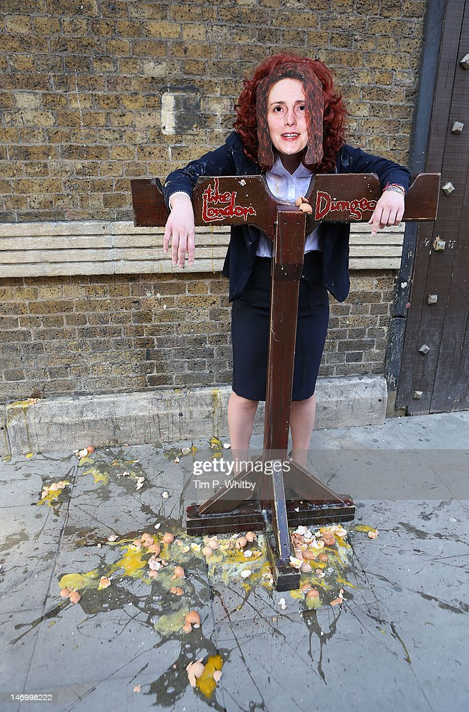 A model poses as Rebekah Brooks as she is condemned to the stocks after being voted as the least loved public figure at The London Dungeon on June 25, 2012 in London, England.