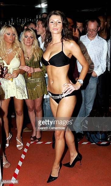 A model poses as she participates in the catwalk show for the Gridmodels 2006 Calendar Catwalk Competition at The Penthouse on August 24 2005 in...