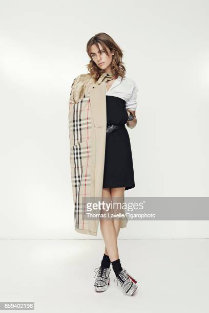 Model poses at a fashion shoot for Madame Figaro on July 21 2017 in Paris France Trench shirt skirt belt watch socks shoes PUBLISHED IMAGE CREDIT...
