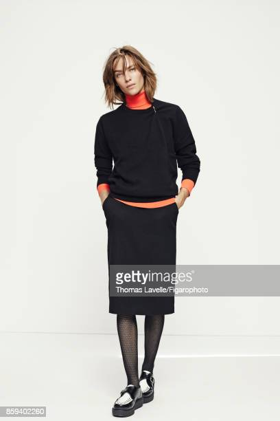 Model poses at a fashion shoot for Madame Figaro on July 21 2017 in Paris France Sweater brooche shirt skirt tights shoes PUBLISHED IMAGE CREDIT MUST...