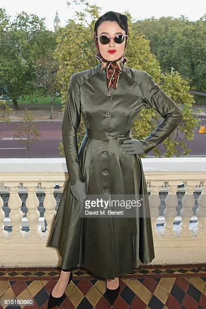 A model poses at a presentation featuring costumes from new Netflix Original series 'The Crown' with designer Michele Clapton at the ICA on October...