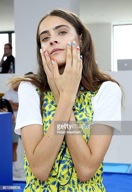 A model poses at Tanya Taylor Presentation September 2016 during New York Fashion Week at Spring Studios on September 9 2016 in New York City