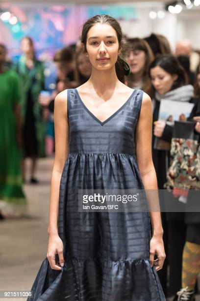 A model poses at the A by Jigsaw Presentation during London Fashion Week February 2018 at St James Emporium on February 20 2018 in London England