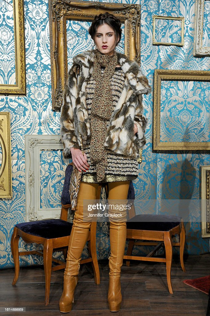 A model poses at the Alice + Olivia By Stacey Bendet Fall 2013 fashion show presentation during Mercedes-Benz Fashion Week at Highline Stages on February 11, 2013 in New York City.