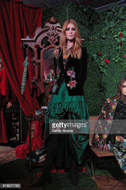 A model poses at the Alice Olivia By Stacey Bendet Presentation during New York Fashion Week at Industria Studios on February 13 2018 in New York City