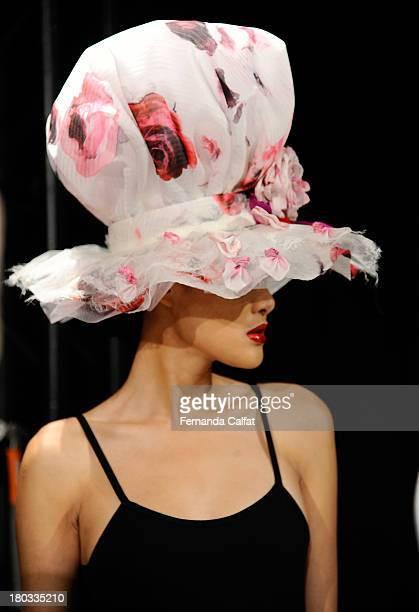 A model poses at the Anya Caliendo fashion presentation during MercedesBenz Fashion Week Spring 2014 at The Box at Lincoln Center on September 11...
