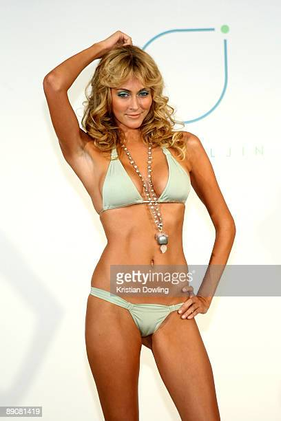 A model poses at the Crystal Jin 2010 fashion show during MercedesBenz Fashion Week Swim at the Penthouse at The Raleigh on July 17 2009 in Miami...