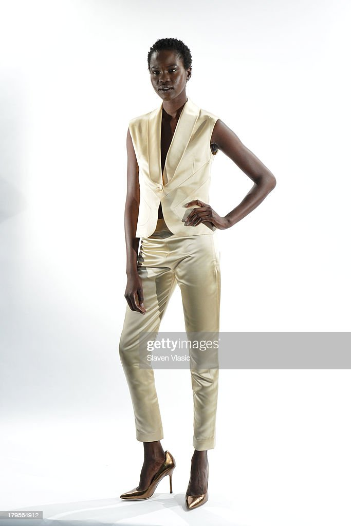 A model poses at the David Tlale Spring 2014 fashion presentation during Mercedes-Benz Fashion Week at The Box at Lincoln Center on September 5, 2013 in New York City.