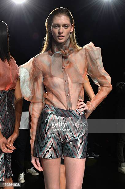 A model poses at the David Tlale Spring 2014 fashion presentation during MercedesBenz Fashion Week at The Box at Lincoln Center on September 5 2013...