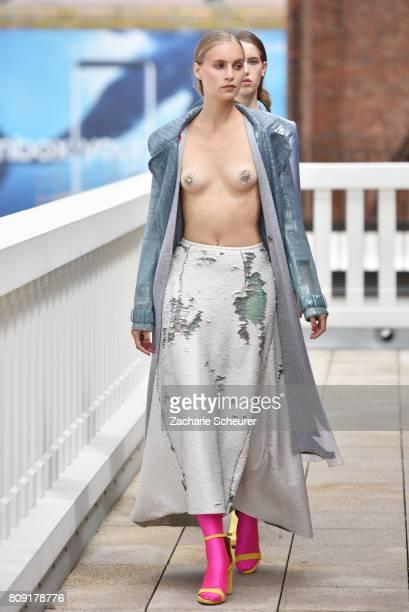 A model poses at the Dawid Tomaszewski Defile during 'Der Berliner Mode Salon' Spring/Summer 2018 at Kronprinzengaerten on July 5 2017 in Berlin...