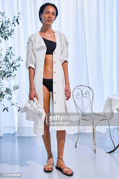 A model poses at the Eudon Choi Ready to Wear Spring/Summer 2021 fashion show during London Fashion Week September 2020 at Noho Studios on September...