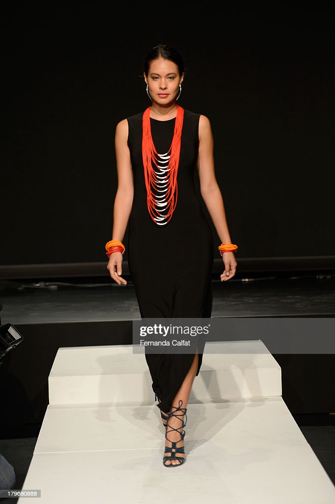A model poses at the Fashion Law Institute Spring 2014 fashion show during Mercedes-Benz Fashion Week at Lincoln Center on September 6, 2013 in New York City.
