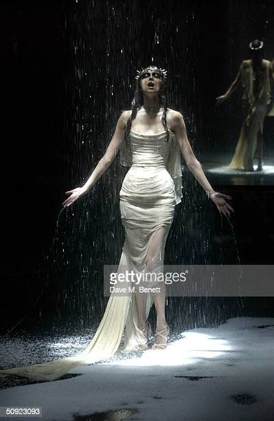 Model poses at the fashion show hosted by Alexander McQueen to mark fifth anniversary of the black American Express Centurion card at Earls Court 2...